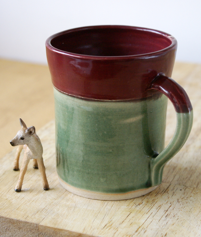 Green and red stoneware coffee mug