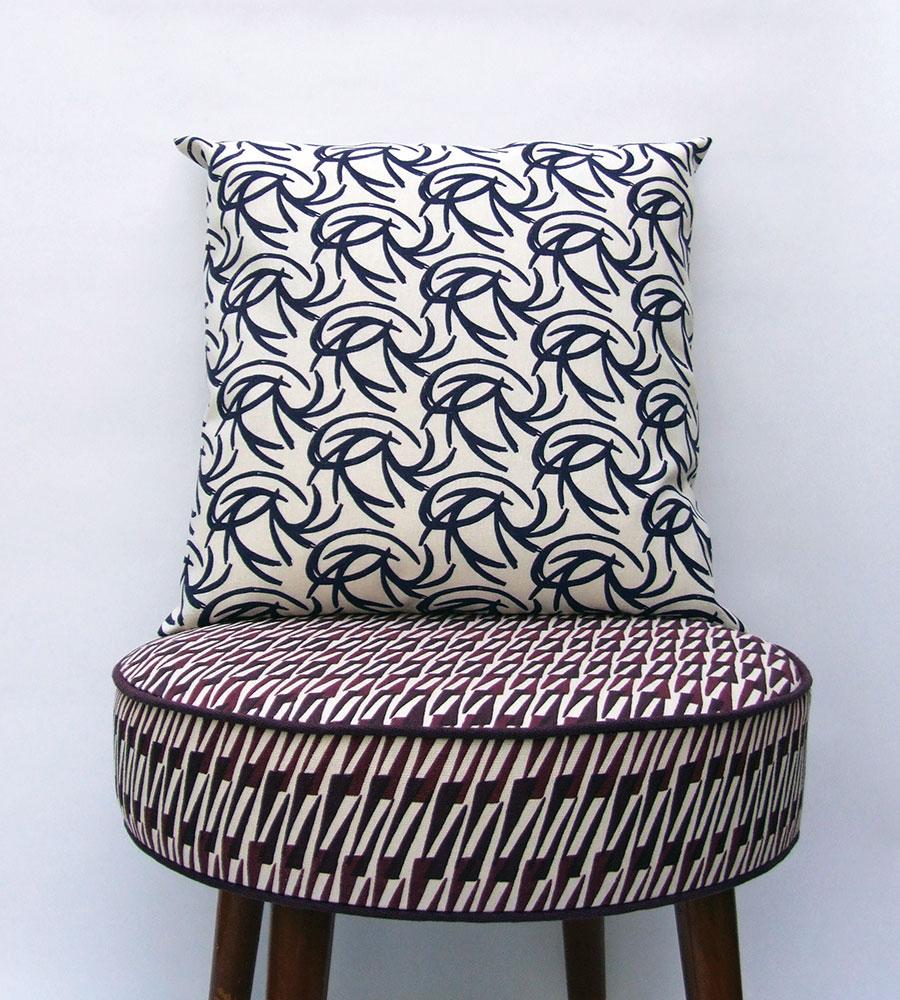 Inferno-cushion-on-footstool-2
