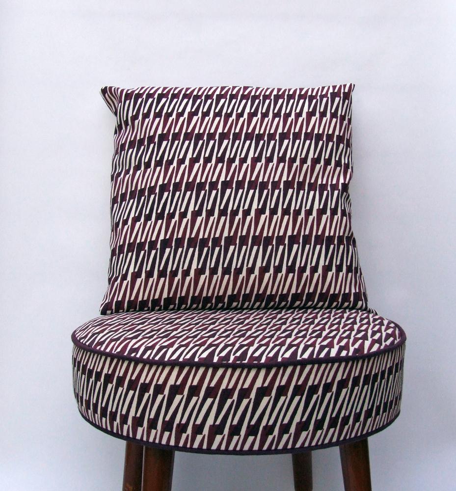 Thorns-cushion-on-footstool